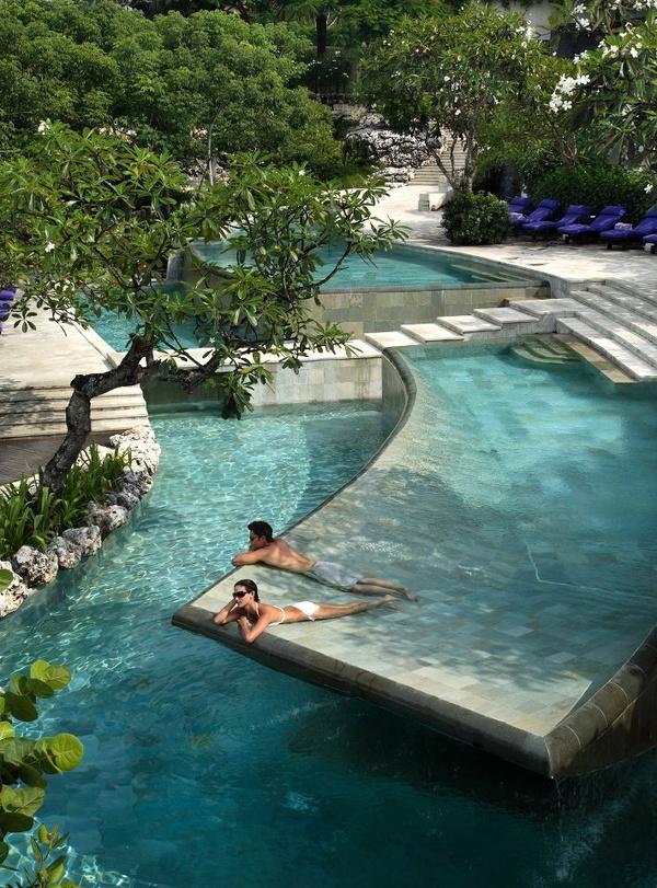 amazing blue pool with sunbathing shelves