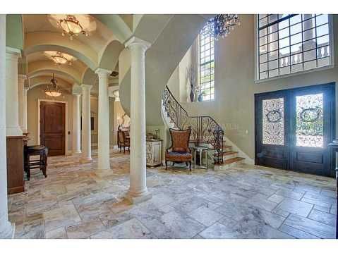 Luxury Mediterranean Estate For Sale in Odessa, FL:  Foyer and Curved Staircase
