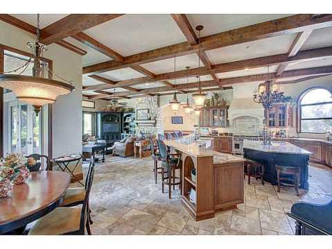 Luxury Mediterranean Estate For Sale in Odessa, FL:  Gourmet Kitchen and Family Room with Fireplace and Wooden Beams