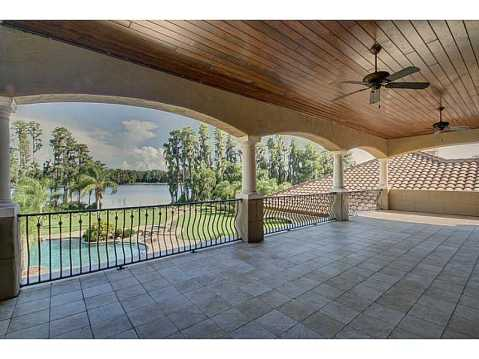 Luxury Mediterranean Estate For Sale in Odessa, FL:  Covered Balcony with Pool and Water View