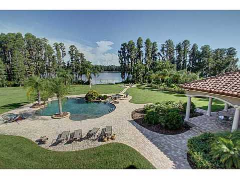 Luxury Mediterranean Estate For Sale in Odessa, FL:  Backyard with Pool and Lake View