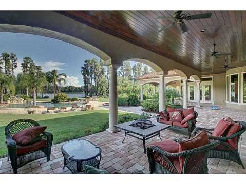 Luxury Mediterranean Estate For Sale in Odessa, FL:  Covered Porch with View of Pool and Lake