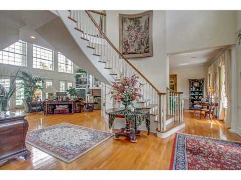 Beautiful Brick Estate for Sale in Odessa:  Curved Staircase in Two-Story Foyer