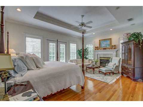 Beautiful Brick Estate for Sale in Odessa:  Master Bedroom with Fireplace