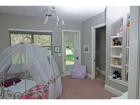 Custom Equestrian Estate for Sale in Plant City:  Kids Bedroom with Built Ins, En Suite, and Princess Bed
