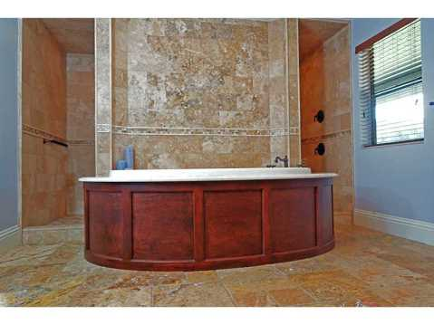 Custom Equestrian Estate for Sale in Plant City:  Master Bathroom with Spa Tub and Walk Through Travertine Shower
