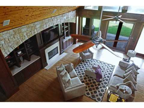 Custom Equestrian Estate for Sale in Plant City:  Vaulted Great Room with Fireplace and Built In Bookshelves
