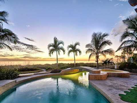 "Beachfront ""Castle"" for Sale in Redington Beach, FL:  Sunset Behind Pool with Bridge"