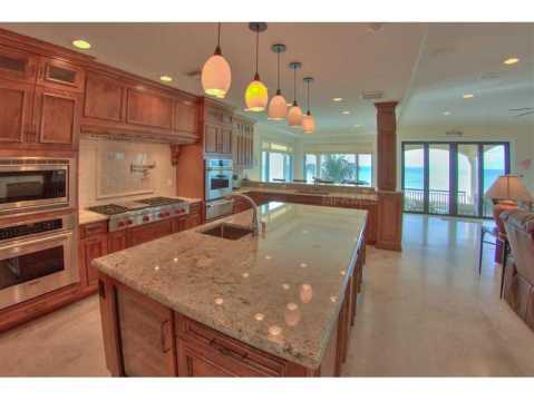 Beachfront Mediterranean For Sale:  gourmet kitchen with granite, stainless steel, and views of the Gulf