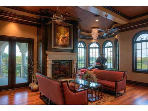 Prestigious Champions Club Home For Sale in Trinity, FL:  Fireplace and Bay Window